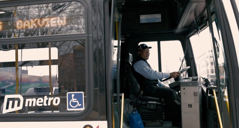 Metro operator aboard the bus