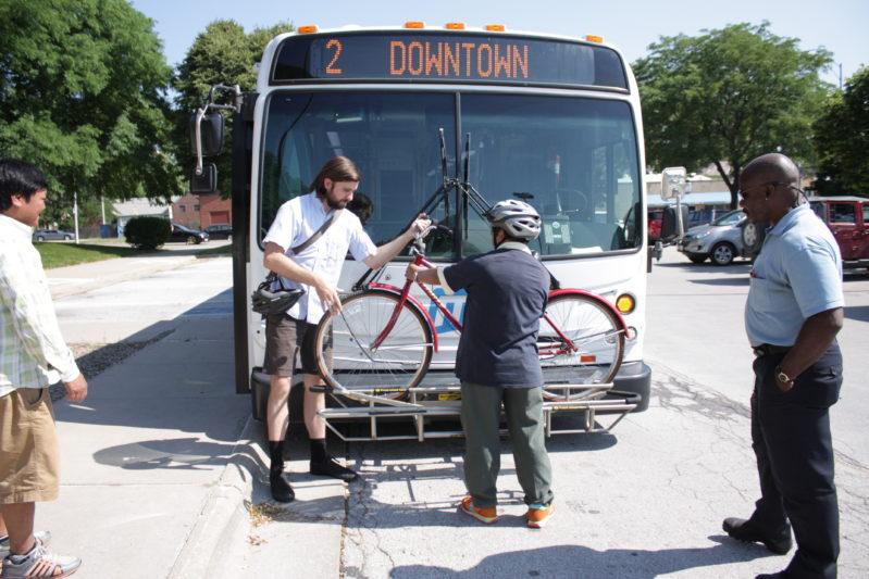 Cyclist loads a bike onto the bus