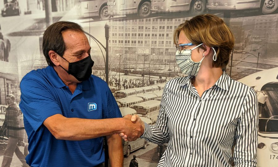Metro's former Executive Director, Curt Simon, shakes hands with incoming CEO, Lauren Cencic.