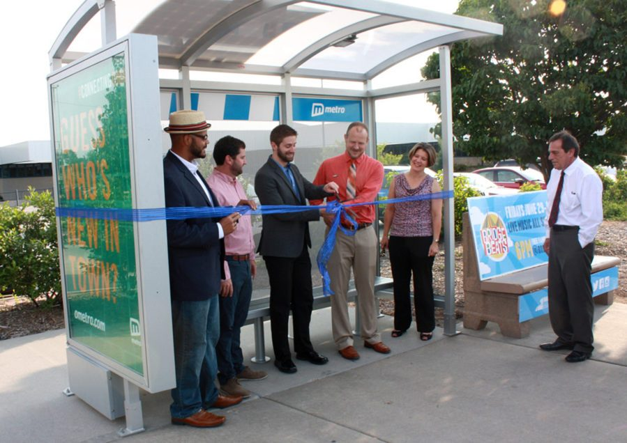 Ribbon cutting of new bus shelter with Metro board of directors